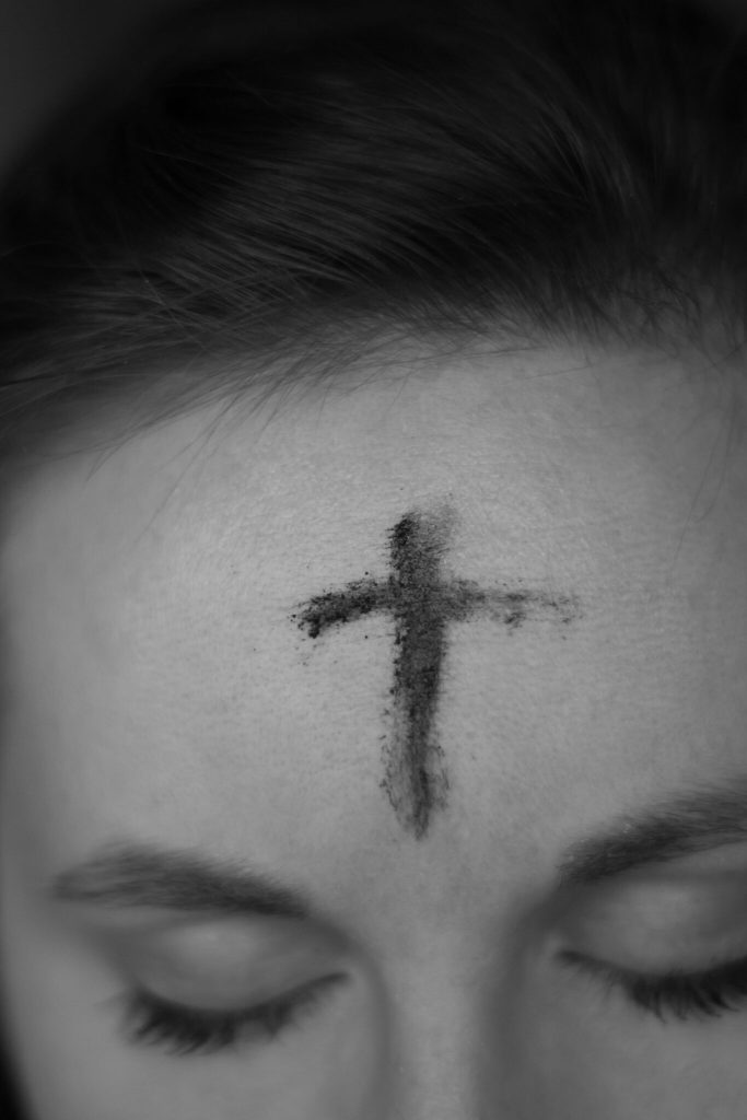 fasting, woman with ash cross