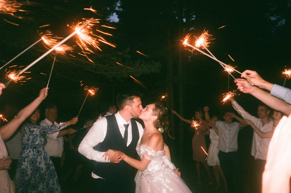 Christian wedding ideas, bride and groom with sparklers