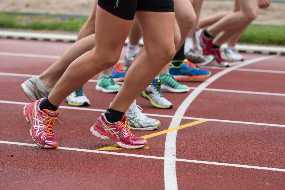 males compete as females, feet at starting line
