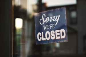 coronavirus facts, sorry we're closed window sign