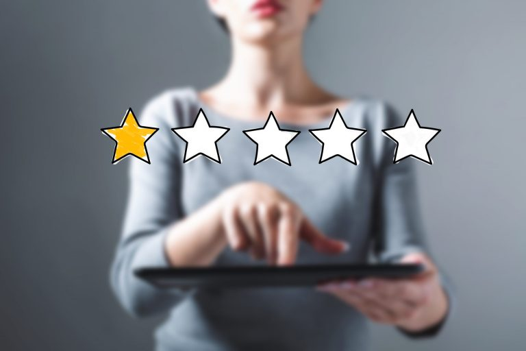 Review writing, one star across woman's sweater