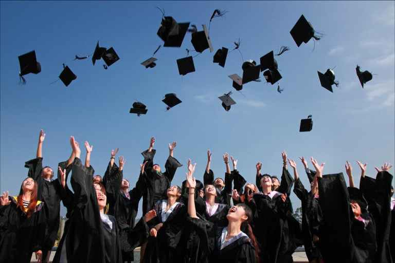 have fun in college, grads tossing caps in air