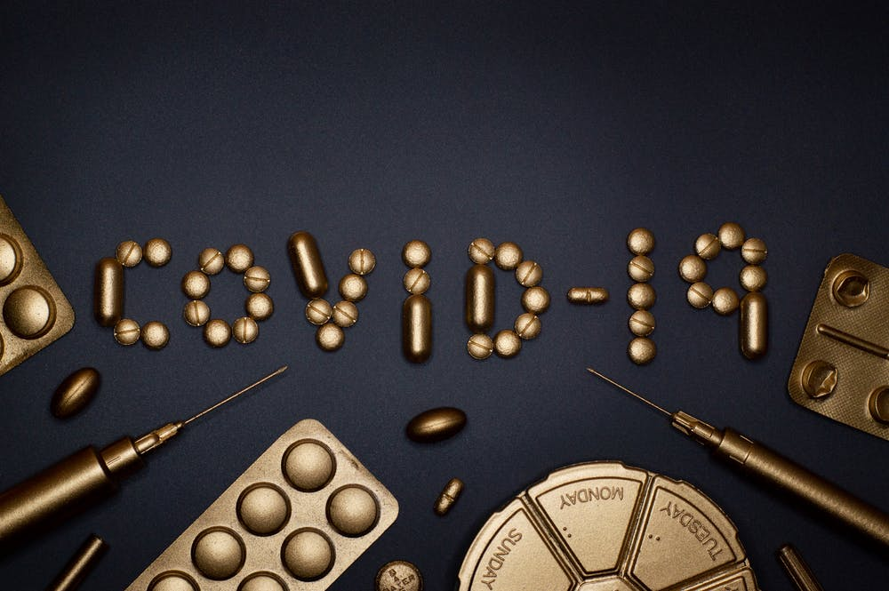 hydroxychloroquine, covid spelled out in gold colored pills
