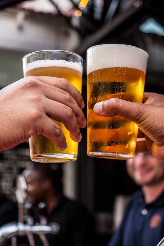 hands clinking beers