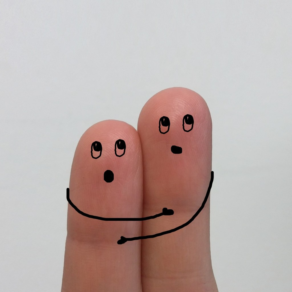 Hugging, two fingers