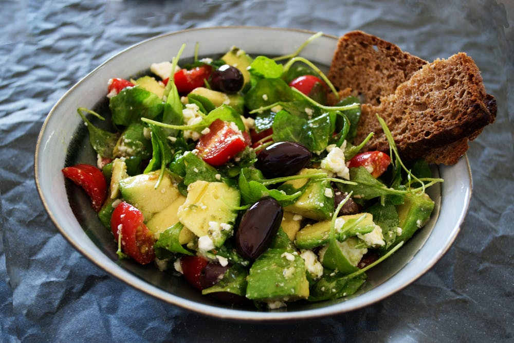 salads, bowl of salad with dark bread on the side