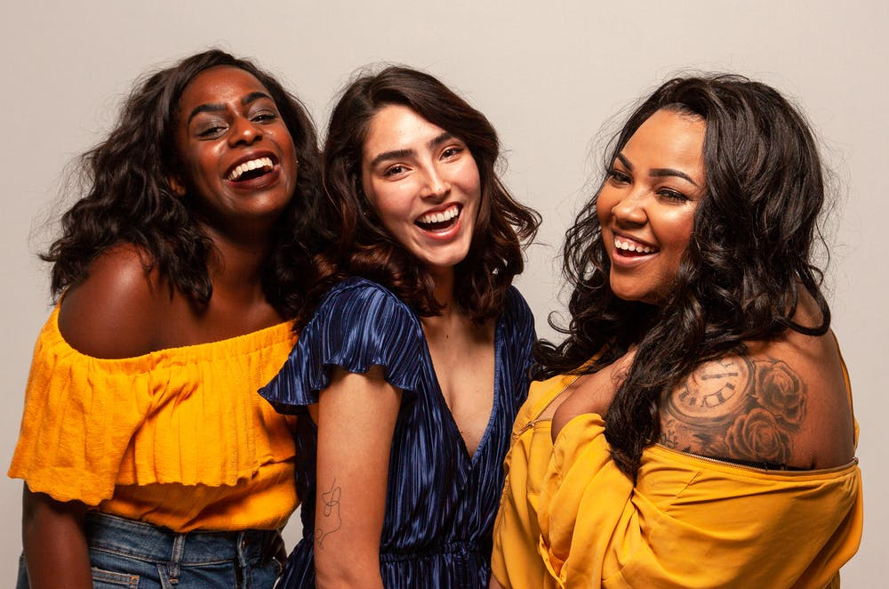 body shaming, three women of different races laughing together