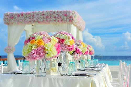 colorful flowers on gazebo tent and table on the beach