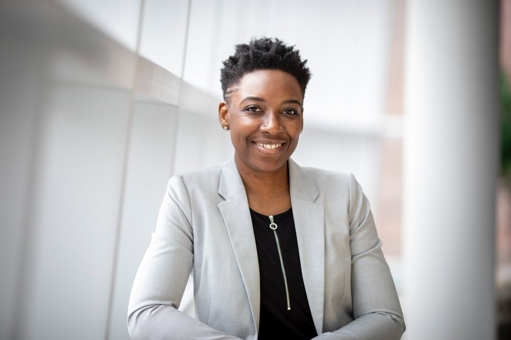 be more confident, smiling black woman with short hair,wearing blazer