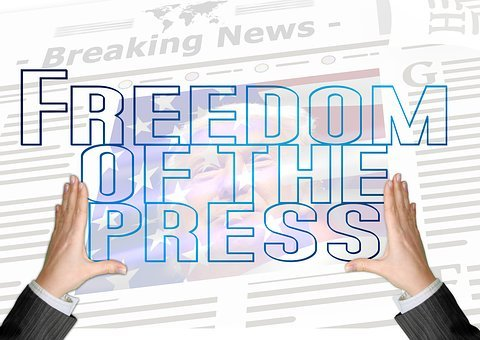 mainstream media, hands holding freedom of the press sign