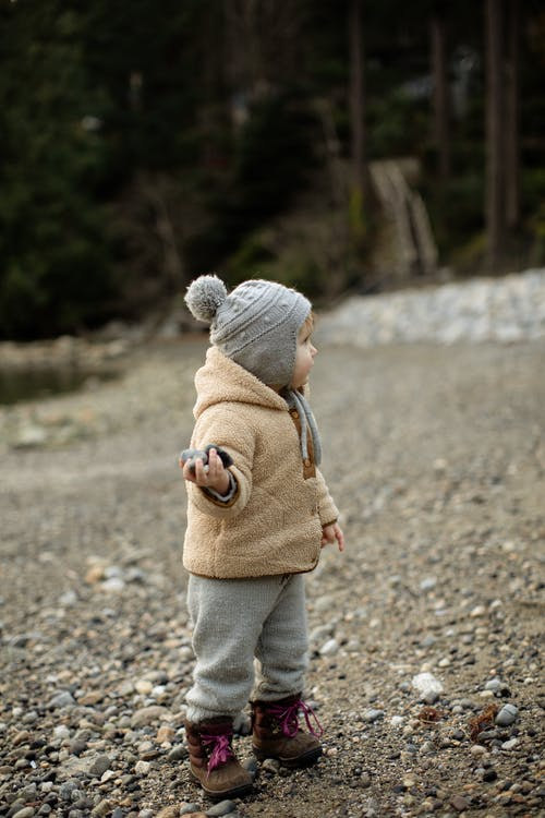 toddler in winter hat and coat