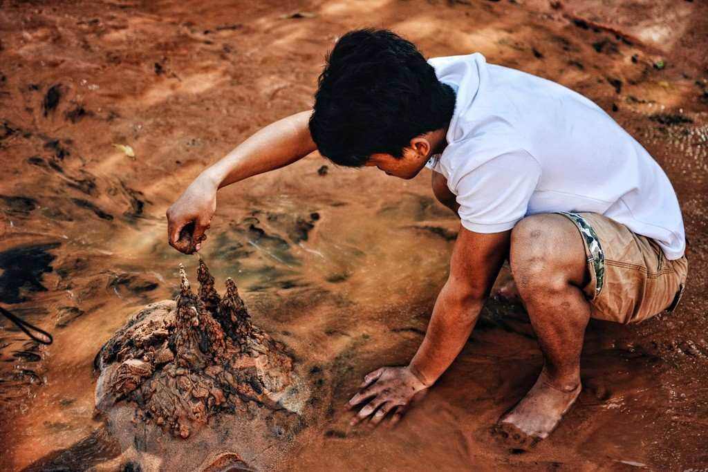 Boy play in mud
