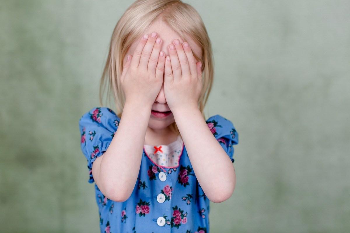 Toddler playing Peekaboo