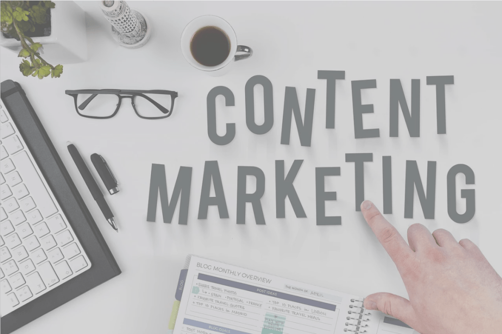 Google, letters spelling out 'content marketing', glasses, cup of coffee, finger pointing