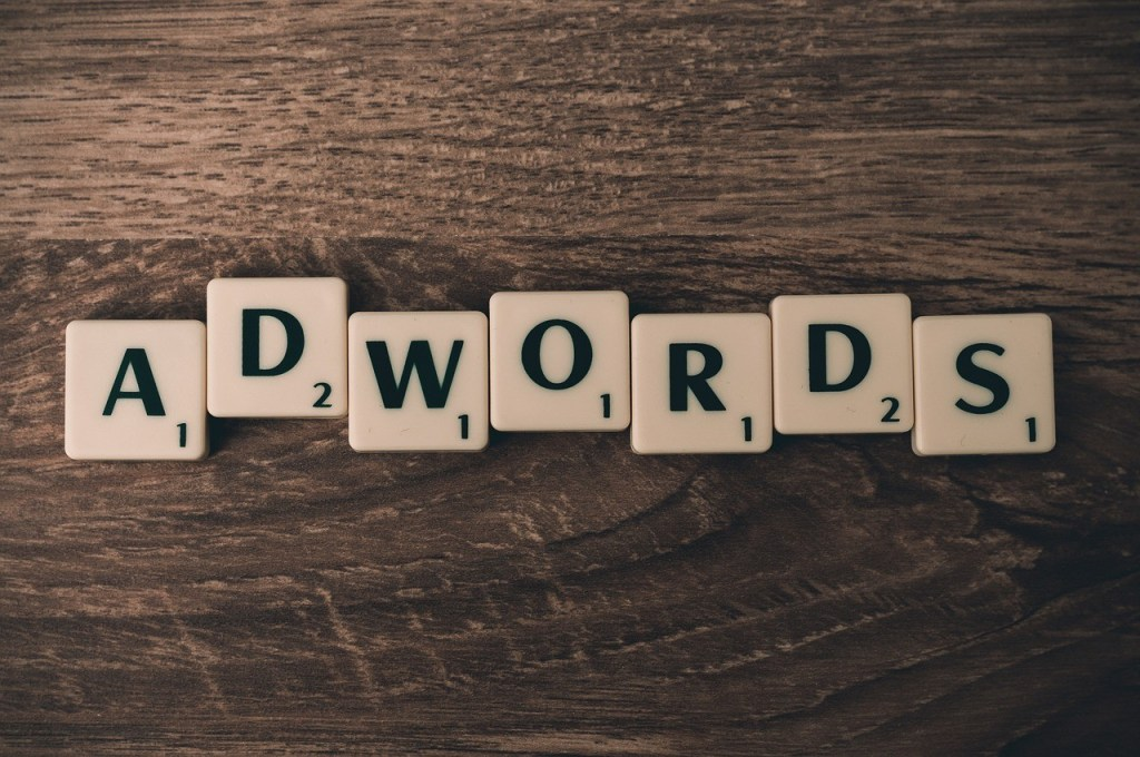 Google, scrabble tiles spelling out 'adwords'