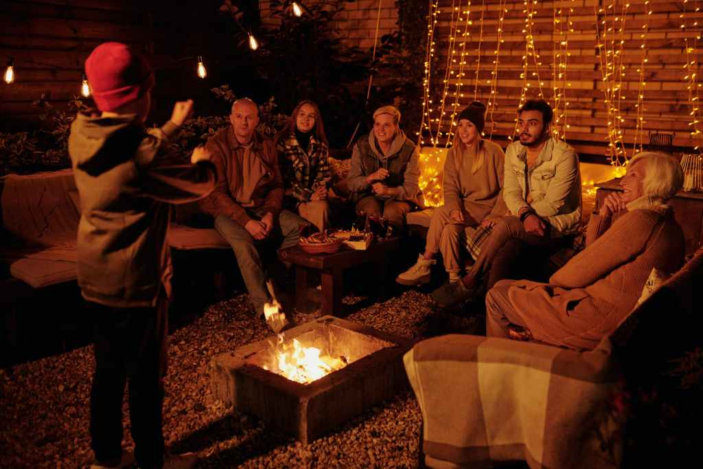 group of people playing charades, firepit