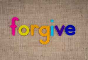 rainbow letters spelling 'forgive'