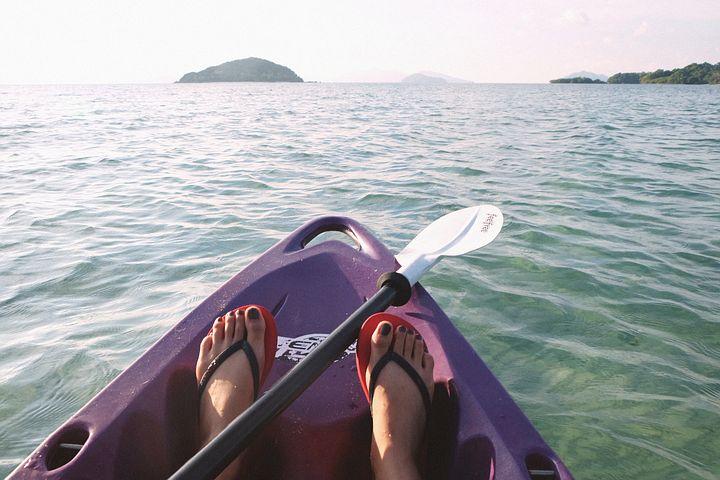 waterway, tip of kayak, paddle, feet wearing flip flops