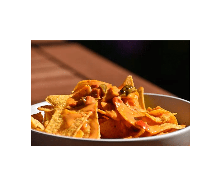 high cholesterol, plate of nacho chips with melted cheese and peppers