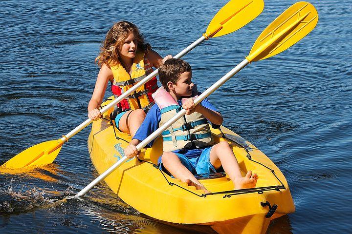 kayaking, woman and boy in yellow kayak