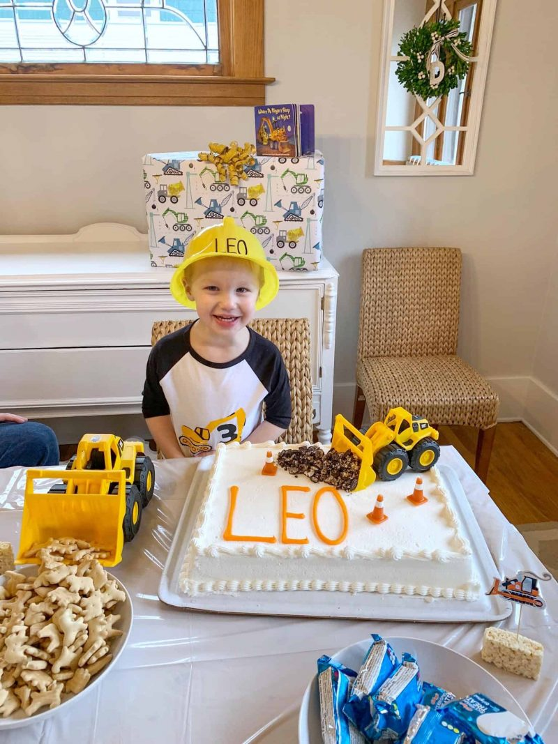 boy in front of birthday cake
