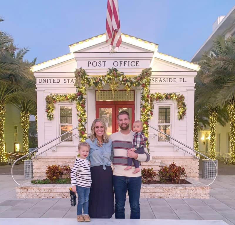 The Ultimate 30A Travel Guide for Families featured by top US travel blog, House of Navy: image of family photo on christmas in front of post office