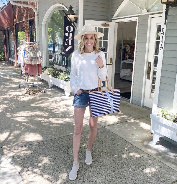 woman sidewalk shopping