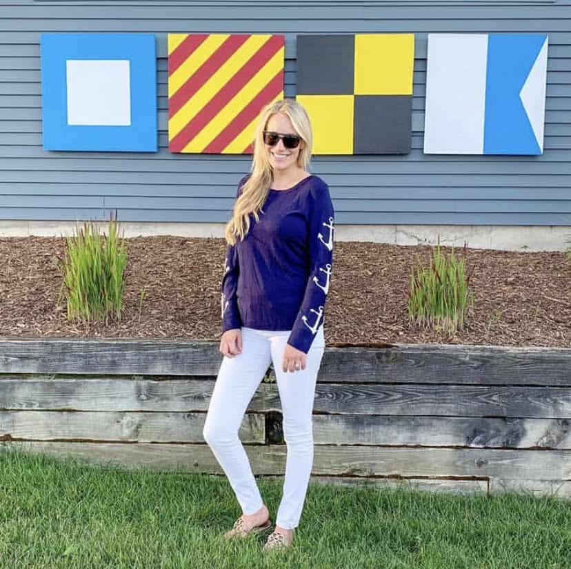 woman in preppy anchor sweater