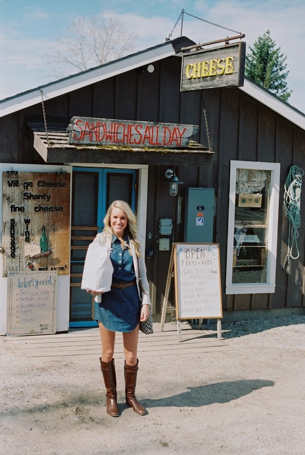 cheese shanty sandwiches | Living in Michigan by popular Michigan lifestyle blog, The House of Navy: image of a woman at the Cheese Shanty in Leland, MI.