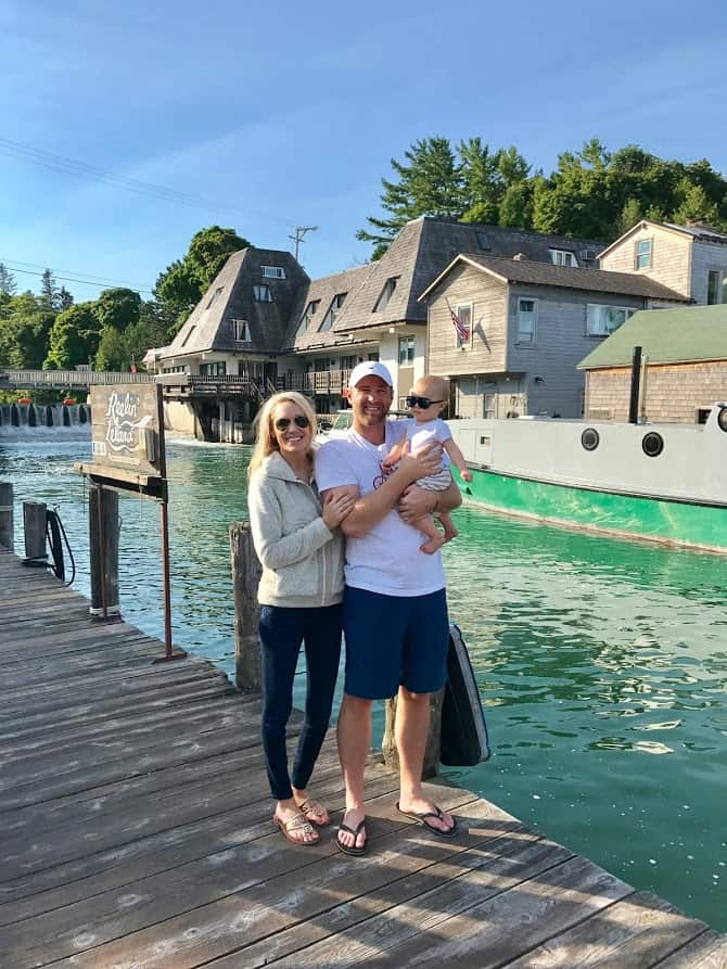 family photo by dam | Living in Michigan by popular Michigan lifestyle blog, The House of Navy: image of a family standing on a dock in Fishtown Leland, MI.
