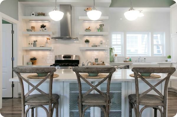 beautiful white kitchen with neutral bar stools and open shelving