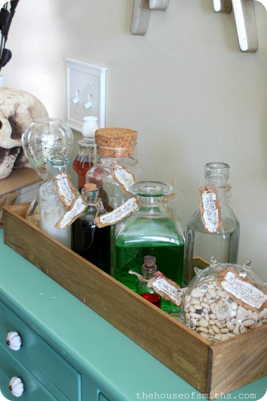 DIY Potion Bottles with Labels - Halloween Vignette - thehouseofsmiths.com #halloweendecorations