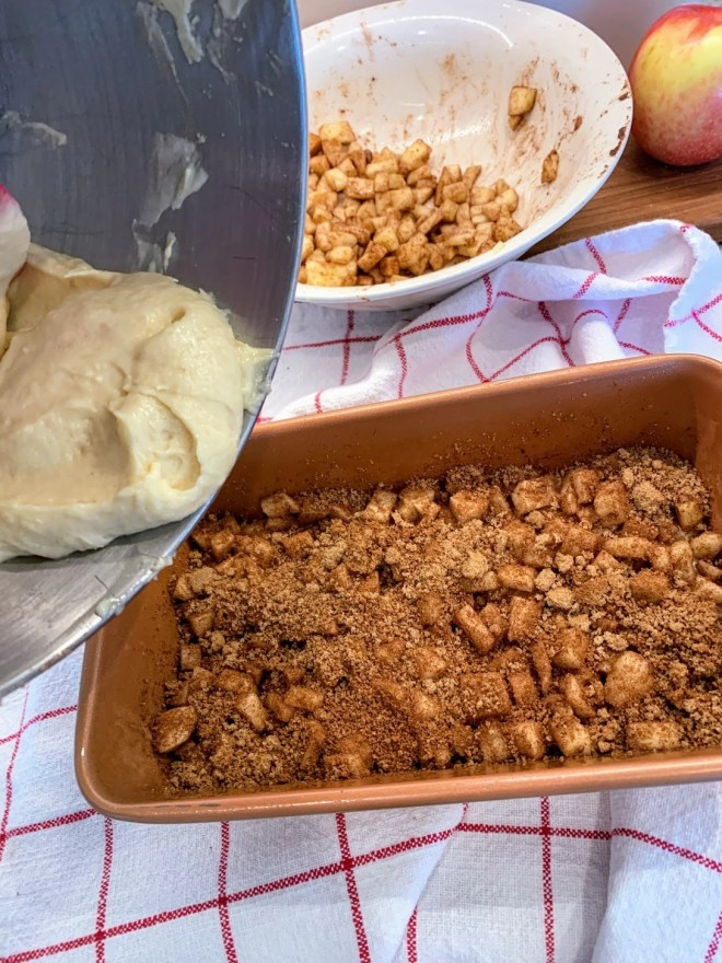 Add another layer of batter over the filling for Farmhouse Apple Fritter Bread with Cider Glaze