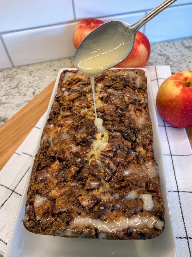 Drizzle glaze over top of Farmhouse Apple Fritter Bread with Cider Glaze