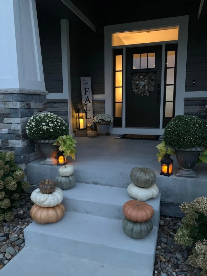 Cozy front porch with warm lighting and lanterns, flameless candles