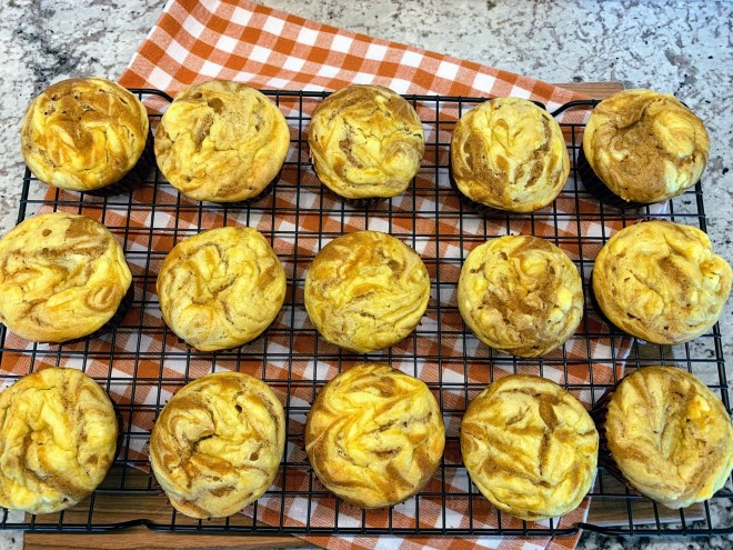 Pumpkin Cheesecake Swirl Muffins fresh from the oven.l