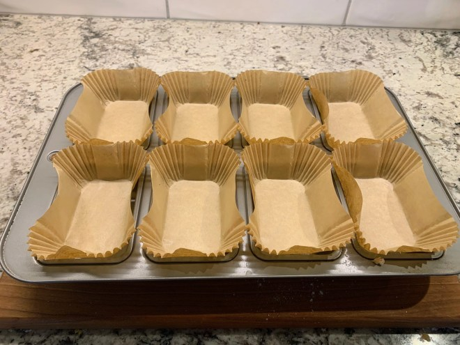 Mini loaf liners in place for this moist and easy pumpkin bread recipe.