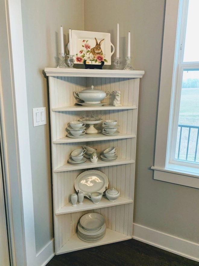 Antique corner cabinet with beadboard.