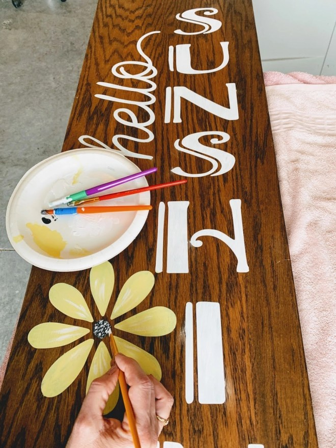 Painting the text on the DIY Reversible Porch Sign