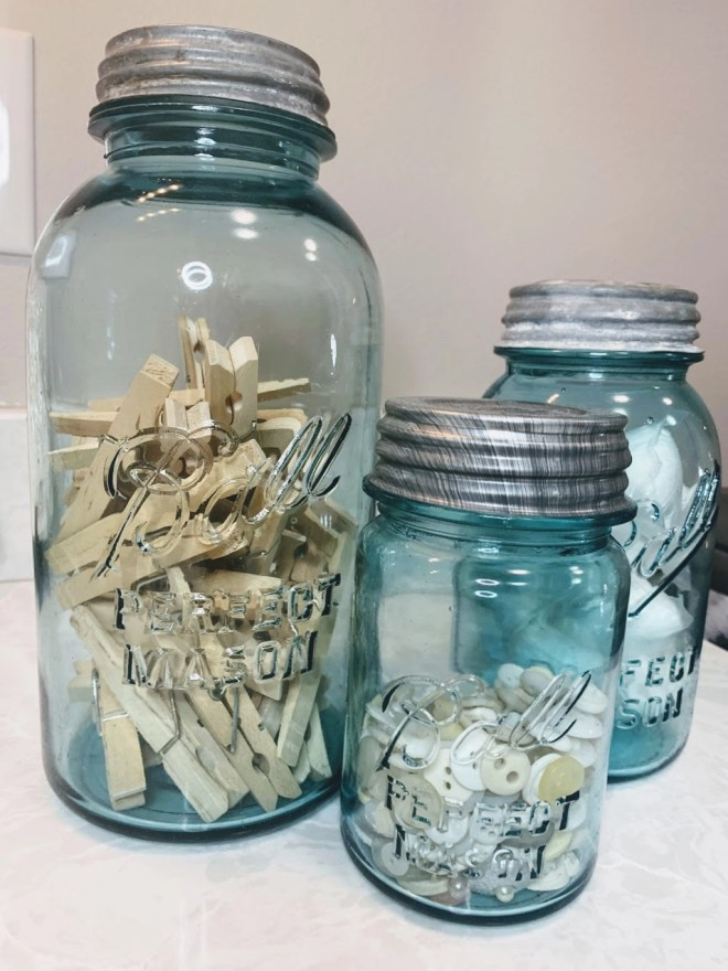 Vintage Ball mason jars for storing laundry supplies.