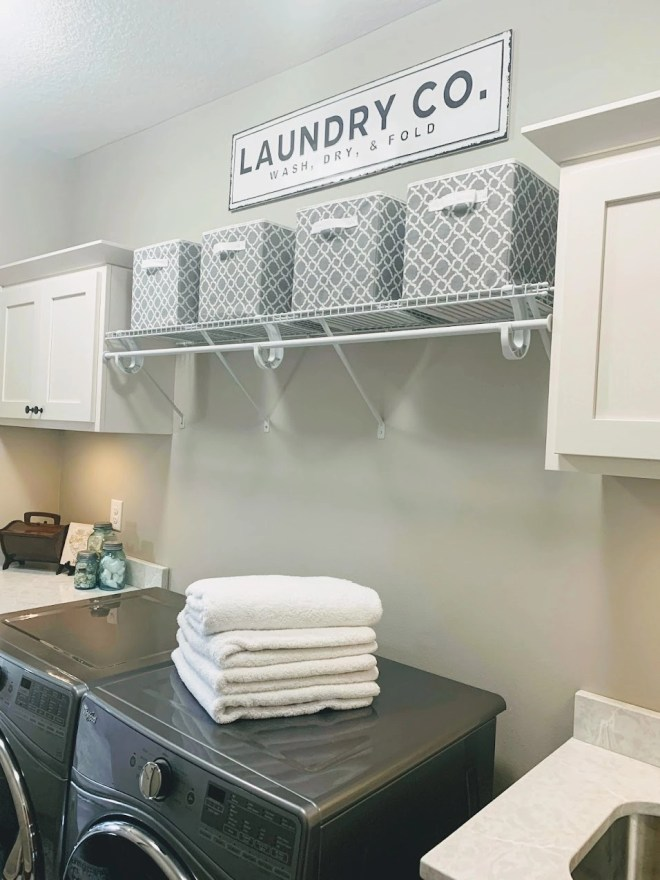 Storage baskets for organization of laundry room.