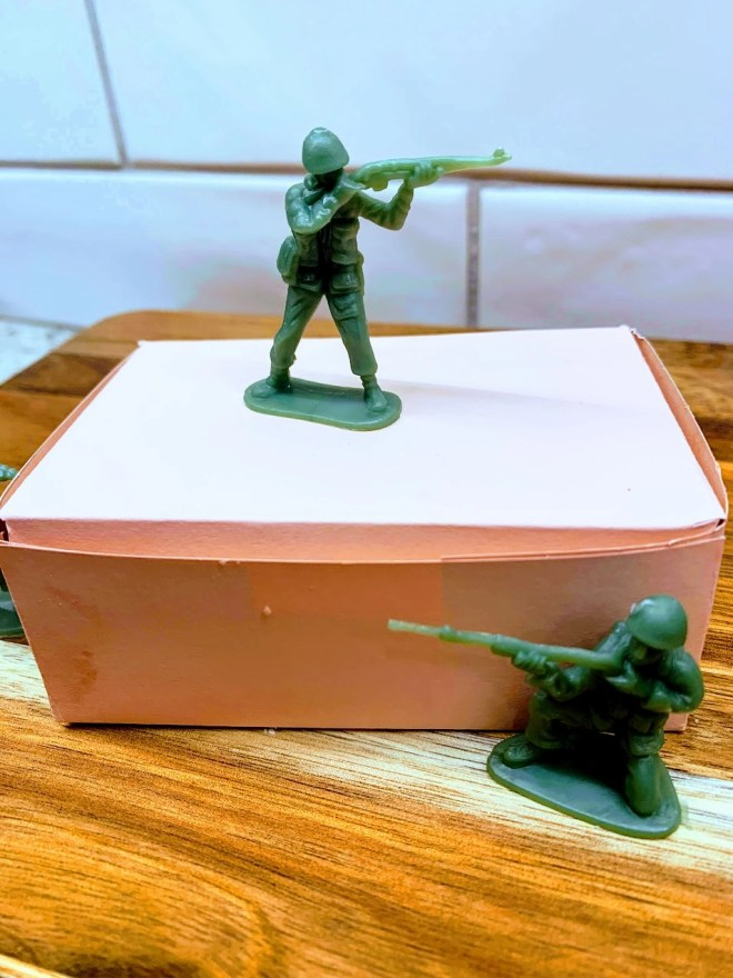 Little green plastic army guys can be given with your Ted Lasso Biscuits with the Boss