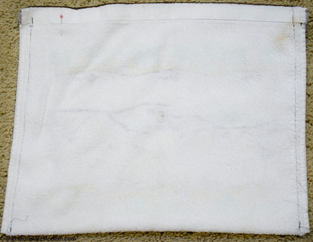 Cut the dishtowel down to the size you want the rice bag. Fold fabric in half. Pin.