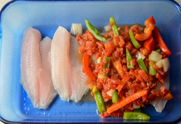 Place vegetable mixture over prepared fish.