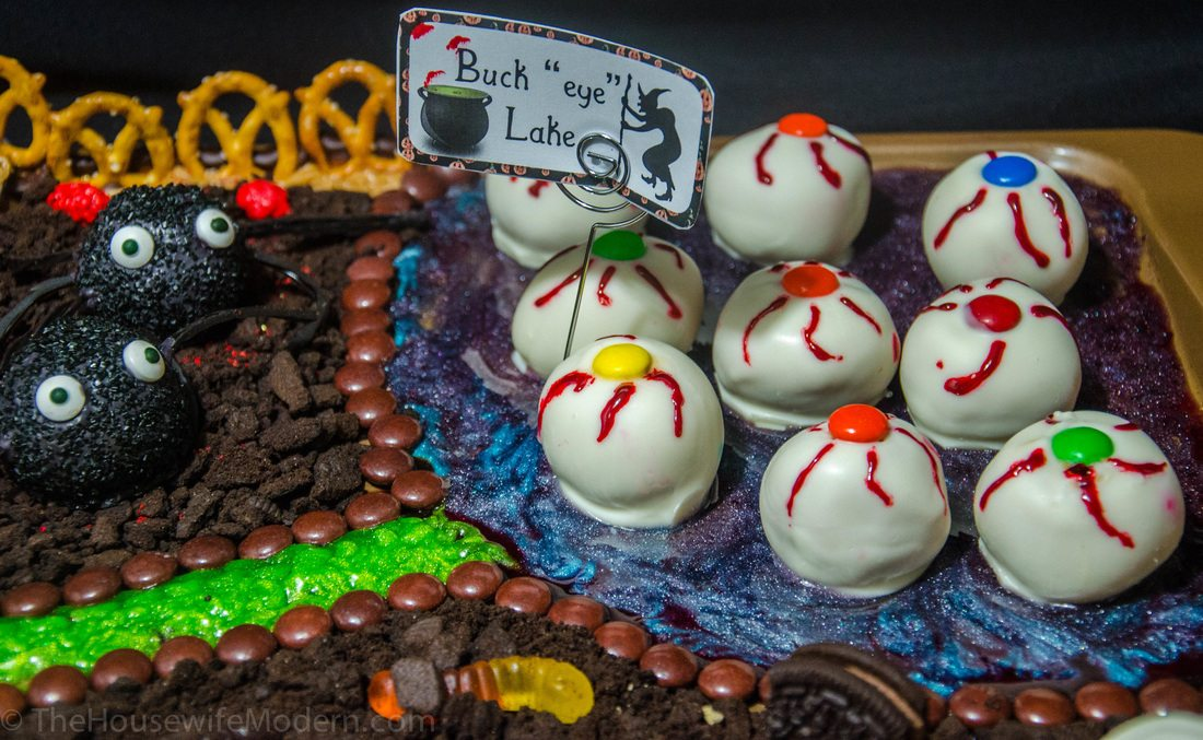 """Irresistible Halloween Buck""""eyes""""- classic buckeyes with white chocolate and decorated just for Halloween."""