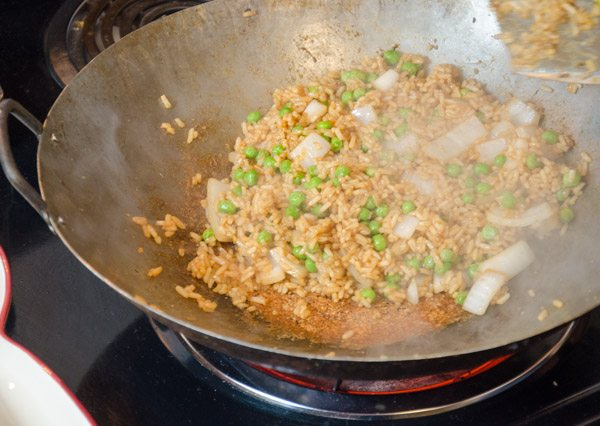 "The rice also needs to actually ""fry"" a bit; don't worry about some sticking."