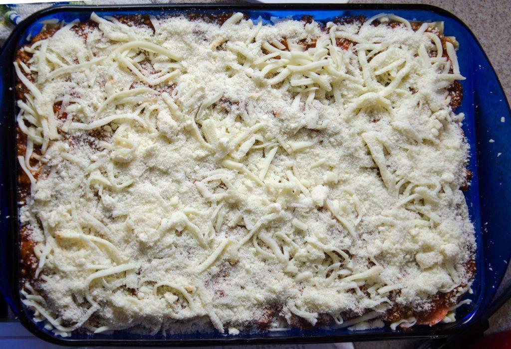 Sprinkle last third of mozzarella over everything. Sprinkle last third Parmesan over everything.