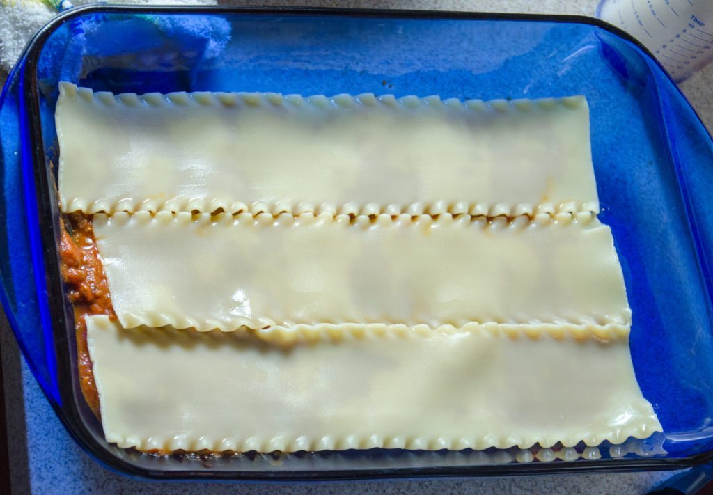 Cover with one layer of noodles.