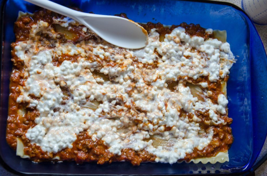 Spread 1/2 of cottage cheese. Sprinkle 1/3 of mozzarella and 1/3 of Parmesan over this.
