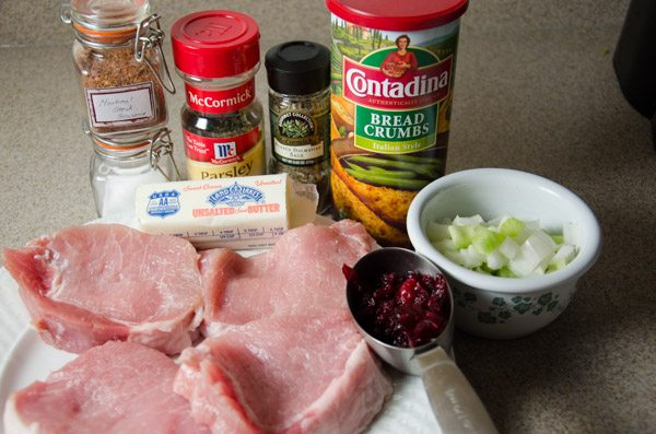 Ingredients: pork chops, cranberries, celery, onion, breadcrumbs, butter, and some spices.